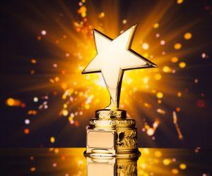 37777060 - gold star trophy against shiny sparks background